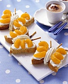 Marzipan cake butterflies with mandarin oranges for children
