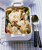 Ham and asparagus gratin in baking dish