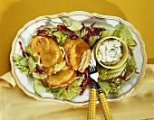 Stuffed celeriac escalopes with herb quark and salad