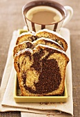 Three slices of marble cake and cup of coffee