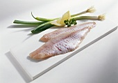 Redfish fillets on chopping board