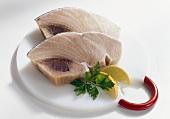 Swordfish fillets on plate