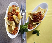 Pasta parcels with meat filling and mince and tomato sauce