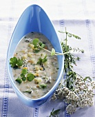 Spring soup with vegetables and herbs