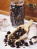 Malt sweets on scoop and in storage jar