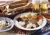 Boiled beef with horseradish sauce and vegetables