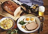 Meatloaf (Leberkäse), fried egg, potato salad, mustard & beer