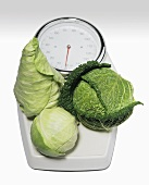 Three cabbages on scales