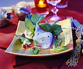 Marinated plaice fillet with pomegranate seeds and salad