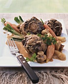 Ox-tail ragout with kidneys, vegetables and mushrooms