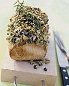 Loin of pork with olive and herb crust