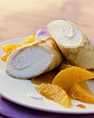 Crepes filled with Grand Marnier whip with orange segments