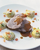Veal shank with gravy and soft cheese ravioli