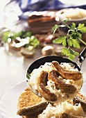 Sausages with sauerkraut and potato pancake