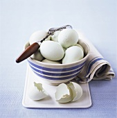 Eggs in china bowl with whisk
