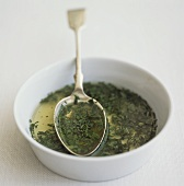 Mint sauce in small white bowl