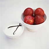 Red plums, sugar and vanilla pods