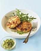 Salmon cakes with rocket and mayonnaise