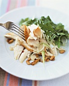 Chicken breast, sliced, with tahini sauce and pine nuts