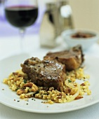 Lamb chops with bulgur wheat and nuts