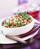 Couscous salad with peppers, spring onions and herbs