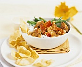 Pork with peppers, chick-peas, rice and crisps