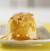 Vanilla ice cream with honey and pine nuts