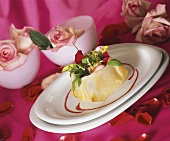 Green salad with rose petals in filo pastry shell