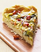 Piece of leek quiche with diced bacon