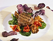 Beef fillet with blue potato crisps, mushrooms and spinach