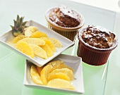 Coconut soufflés with fresh pineapple and oranges