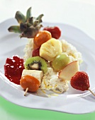 Exotic skewered fruit on lemon rice