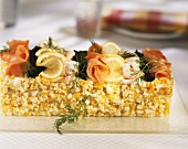 Cold fish cake with salmon, caviare, shrimps and lemon