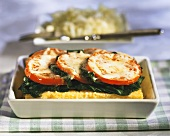 Polenta bake with spinach and tomatoes