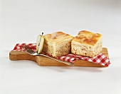 Two pieces of honey apple cake on chopping board