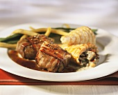 Beef fillets wrapped in bacon with brandy sauce