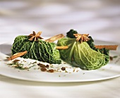 Savoy cabbage roulades in yoghurt sauce with raisins & spices