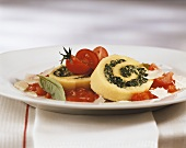 Polenta roulade with spinach filling in tomato sauce