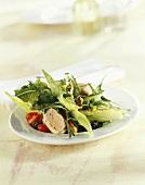 Salad leaves with roast rabbit