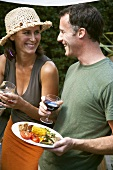 Couple enjoying wine at barbecue