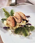 Pheasant breast on parsnip puree with fir branches