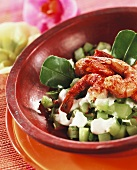 Spicy shrimps on minted cucumber relish