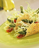 Curly endive with asparagus & cherry tomatoes in Parmesan shells