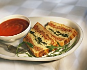 Macaroni and spinach terrine with tomato sauce