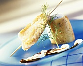 Monkfish fillet on skewer with baked potato