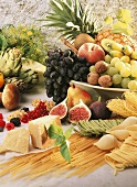 Fruit still life with Parmesan, pasta and nuts