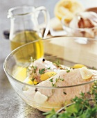 Marinating chicken with olive oil and herbs