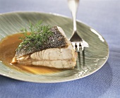 Baked turbot in meat stock