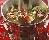 Fondue with meat, vegetables and shrimps (China)