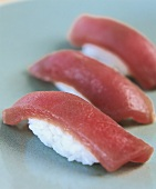 Three nigiri-sushi with tuna